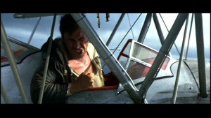 Originalet till Snakes on a plane: Indiana Jones möter piloten Jocks tama orm Reggie.